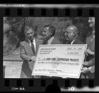 George Deukmejian, Daryl Gates, and Sherman Block with check for Gang Suppression Programs, Calif., 1986