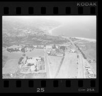 Aerial view of coastline and inland area around Malibu, Calif., 1987