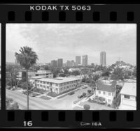 Cityscape of residential area with skyscrapers in background near Century City (Los Angeles), 1987
