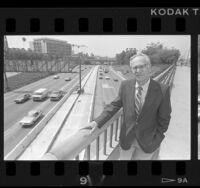 Caltrans' Chuck O'Connell on pedestrian bridge above the Harbor Freeway, Calif., 1986