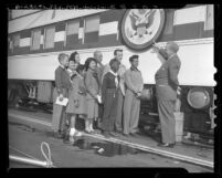 Robert P. Patterson and Dr. William Lindsay Young with children besides Freedom Train during it's stop in Los Angeles, Calif., 1948
