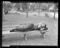 Joseph Raymond White-Eagle, disabled Indian war veteran, showing how he slept on park bench in Los Angeles, Calif., 1948