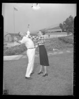 Los Angeles police candidate Irene LaQua tries out defense moves on Sgt. J.W. O'Bryan, 1948