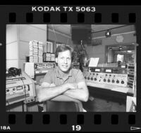 Disc jockey Rick Dees in KIIS FM studio, Calif., 1986