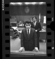 "Sociz ""Johnny"" Junatanov and lawyer Joel Isaacson in court, Los Angeles, Calif., 1986"