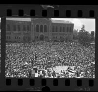 "UCLA's Royce Hall Quad filled with students as Zubin Mehta conducts peace music from Handel's ""Messiah,"" 1970"