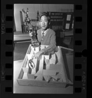 Mark Sato with his maze project that won a trophy at Science Fair at the California Museum of Science and Industry, 1970