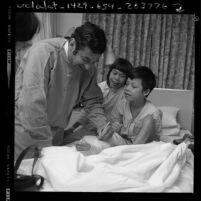 Dr. Leonard M. Linde signing cast for a war injured Vietnamese child hospital in Northridge, Calif., 1970