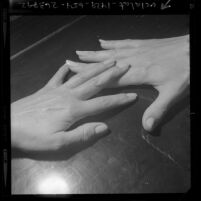 Hands of two women touching; used for a story on gay women, 1970