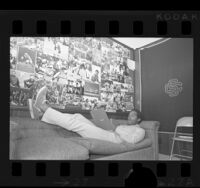 Football player O.J. Simpson relaxing on a couch, 1970