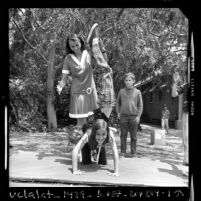 1956 Olympic gold medalist Olga Connolly-Fikotova playing with children at UCLA elementary school, 1970