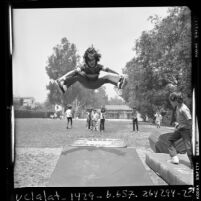 Children playing on a trampoline at UCLA elementary school, 1970