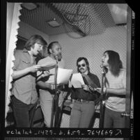 Satirical comedy team, The Credibility Gap, performing in radio station sound room in Los Angeles, Calif., 1970