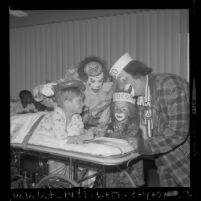 Ringling Bros. and Barnum & Bailey Circus clowns Coco and Bobby Kaye visiting a patient at Los Angeles Orthopaedic Hospital, 1970