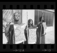 Three Children of God members wearing sackcloth holding signs declaring Judgment Day is coming in Los Angeles, Calif., 1970