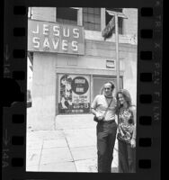 Arnold Dietrich, leader of Los Angeles Children of God, with his wife Faith Berg, in front of the sect's Skid Row building, 1970
