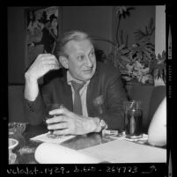 Writer Louis Studs Terkel seated at restaurant table in Los Angeles, Calif., 1970