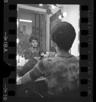 Gabe Kanata wearing wig over long hair, Los Angeles, Calif., 1970