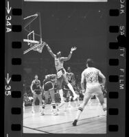 Wilt Chamberlain making a dunk during Los Angeles Lakers vs Milwaukee Bucks game, 1971