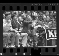 UCLA basketball coach, John Wooden courtside during game, 1971