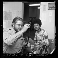Television reporter Gail Christian with editor Chuck Kocsis at KNBC-TV, Los Angeles, Calif., 1967