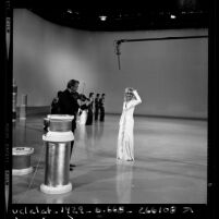 Actress Goldie Hawn rehearsing for a television special with her father, violinist, Edward Rutledge Hawn in Los Angeles, Calif., 1970