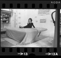 Saleswoman Diana Lundquist demonstrating fire safe waterbed in Hollywood, Calif., 1971