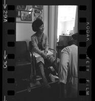California Assemblywoman March Fong Eu getting her boots polished, 1971