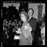 Actress Susan Hayward and Jay Bernstein arriving at Motion Picture and Television Relief Fund in Los Angeles, Calif., 1971