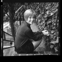 Actress Sandy Duncan seated on ivy covered steps, 1971