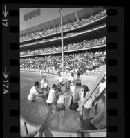 New ministers being baptized during Jehovah's Witnesses assembly at Los Angeles' Dodger Stadium, 1971