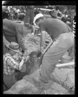 Juan de Lopez is lifted from 1949 pipeline excavation cave-in Pasadena, Calif.