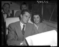 Elizabeth Taylor and husband Conrad Hilton Jr. on bus Long Beach, Calif., 1950