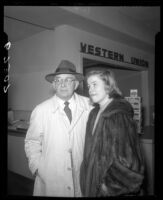 Actress Nancy Olson and her father, H.J. Olsom before Western Union counter at LAX, 1950