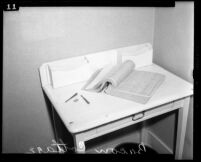 David Bacon murder case; open telephone book on desk found in rented cottage in Laurel Canyon, Calif., 1943