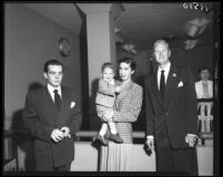 Actor David Brian, Bonita Fielder Davis, her child Michael and Robert Sherman in court for paternity suit, Los Angeles, Calif., 1951
