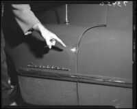 Bullet mark on Joan Bennett's Cadillac automobile, Los Angeles, Calif., 1951