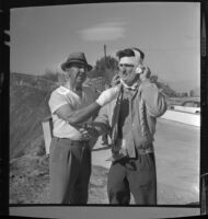 Producer Keith Daniels and singer Billy Vaughn in bandages after fire in Los Angeles, Calif., 1961