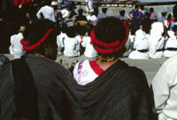 Guelaguetza[?], performers sitting with spectators [view from behind], 1982 or 1985