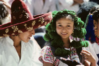 Guelaguetza[?], dancers close-up of man in red hat and woman in green headgear [view 1], 1982 or 1985