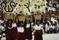 Tlacolula del Valle, women holding flower baskets on their heads, 1985
