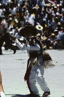San Antonino Castillo, performers throwing gifts to spectators, 1985