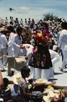 Tehuantepec, woman throwing flowers to spectators, 1985