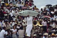Tehuantepec, man carrying fake fish, 1982 or 1985