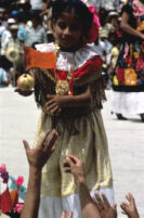 Tehuantepec, girl handing object to spectators, 1982 or 1985