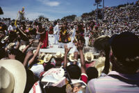 Tehuantepec, performers throwing gifts to spectators, 1982 or 1985