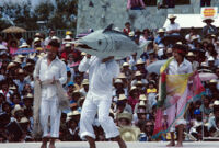 Tehuantepec, man carrying fake fish on shoulder, 1982 or 1985