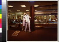 Photographs of Cashin's ready-to-wear designs for Sills and Co. featured in department store windows.