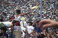 Chines de Oaxaca, performers throwing gifts to spectators, 1982