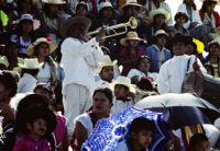Musician signals beginning of festival, 1982